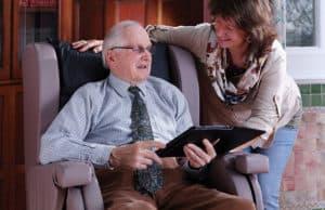 Gentleman sat on a Careflex chair with a woman