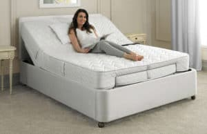 Woman lying on adjustable bed