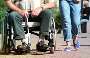 man in a wheelchair with woman