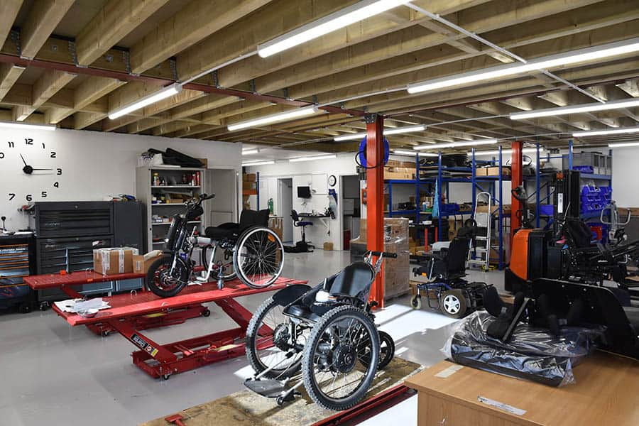 Recare new workshop with custom wheelchairs